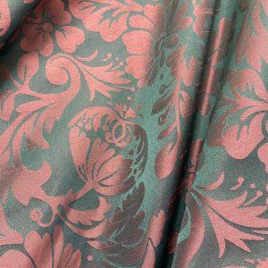 Burgundy Damask Over Dark Green Fabric