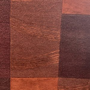 Handcrafted Burgundy And Rust Rug